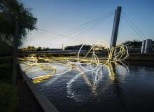 gold light ropes on the water
