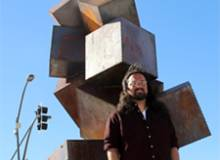 man in front of sculpture