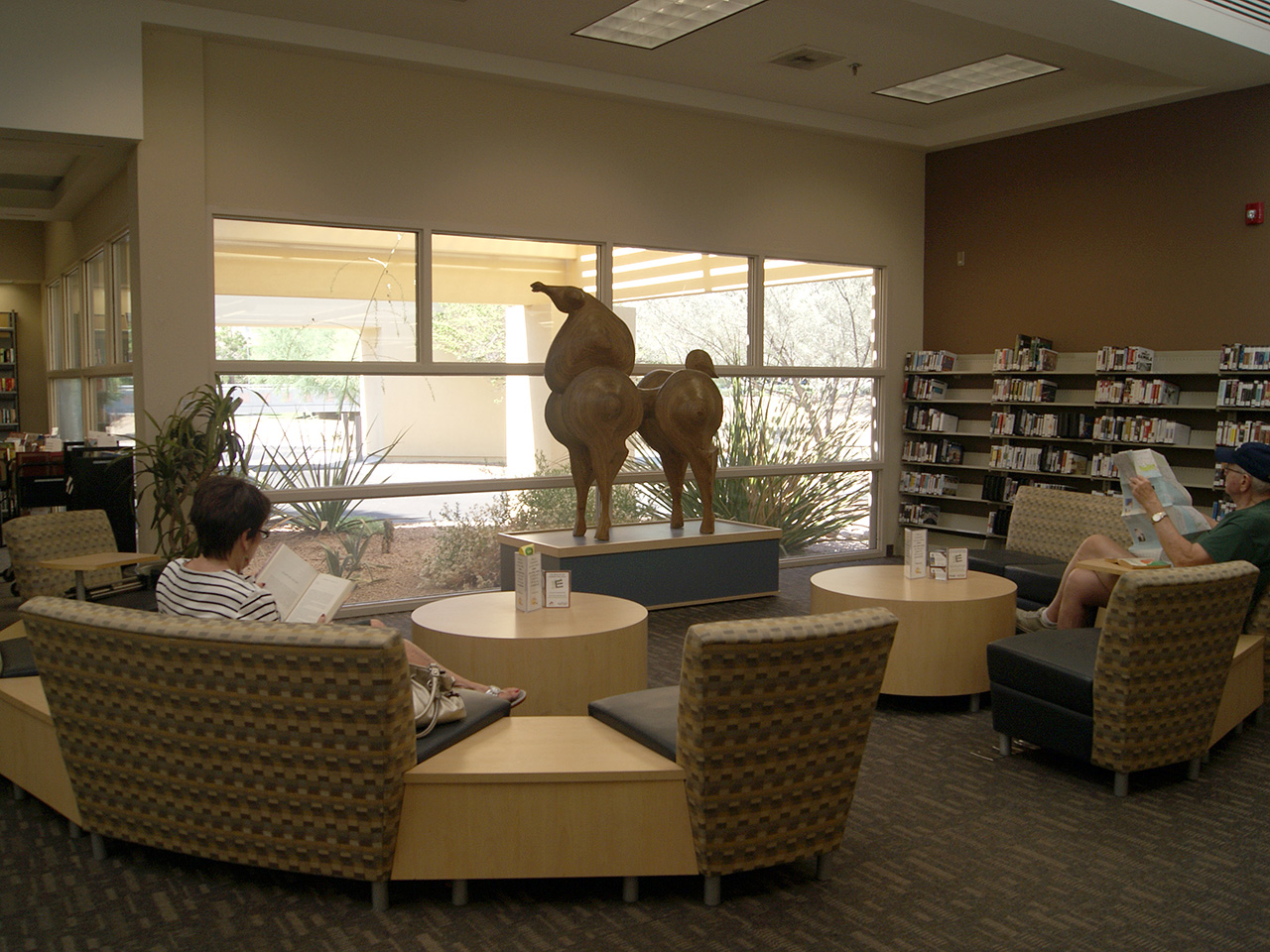 wooden horse sculpture in library