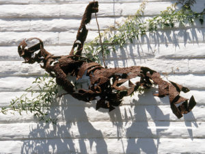 hanging mountain climber sculpture in wall