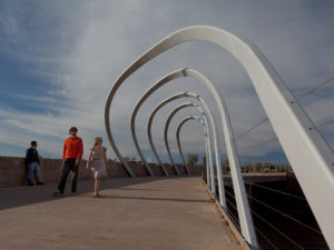 re currents man and woman walking on a bridge