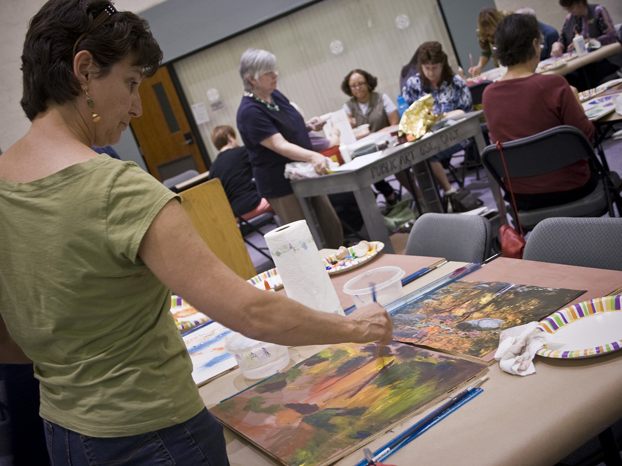 hurricane katrina exhibition with people painting landscape