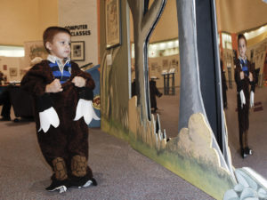 sendak exhibition by jesse tallman with kid in a costume