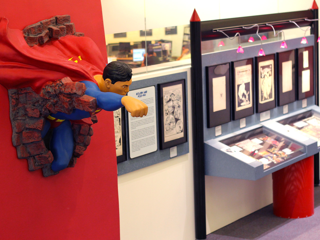 zap pow bam exhibition with superman wall sculpture